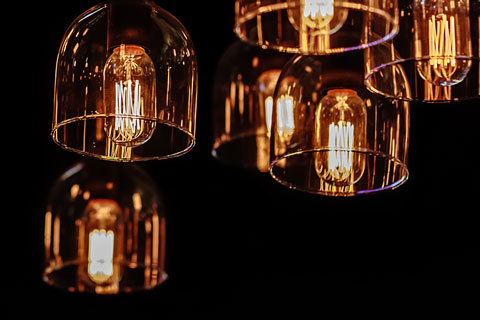 decorative lighting fixtures on a dark background