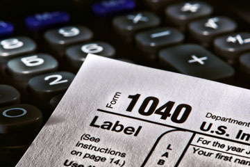 a USA income tax form 1040 and a calculator