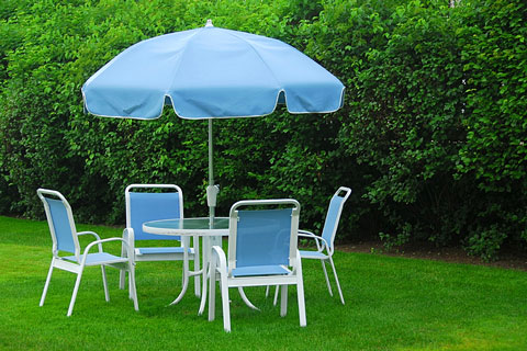 patio furniture on a backyard lawn