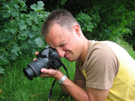 photographer shooting a photo with a digital SLR camera