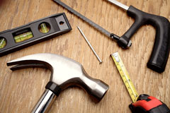 tools - hammer, level, saw, and tape measure