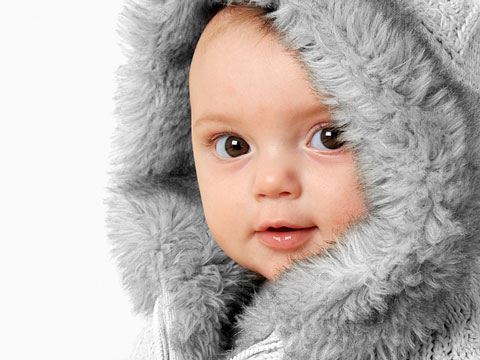 baby girl wearing a winter fur coat